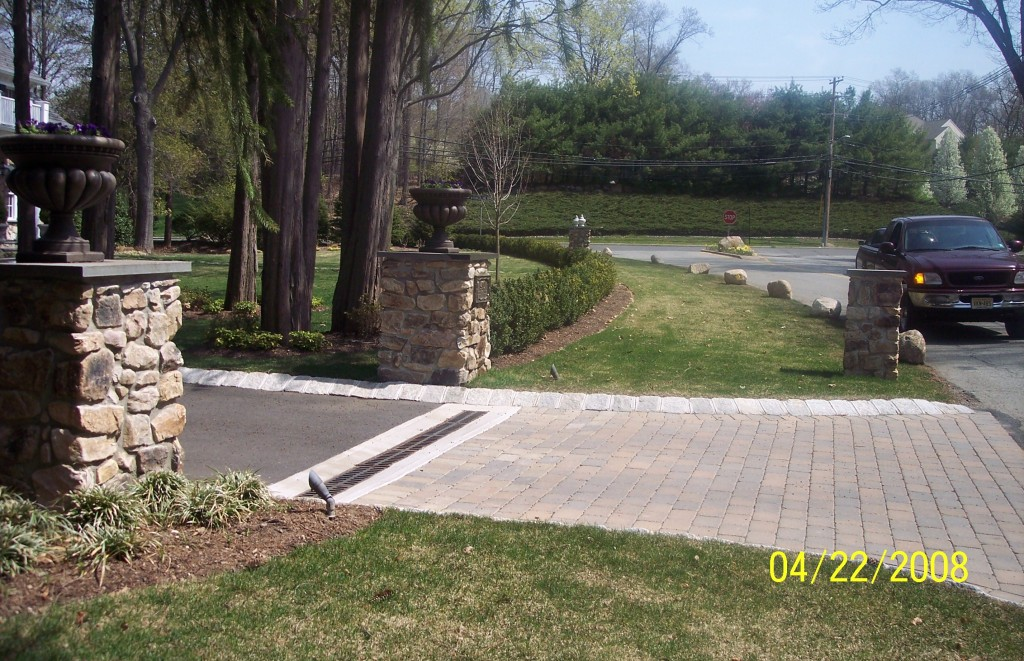 Driveway with pillars and storm drain